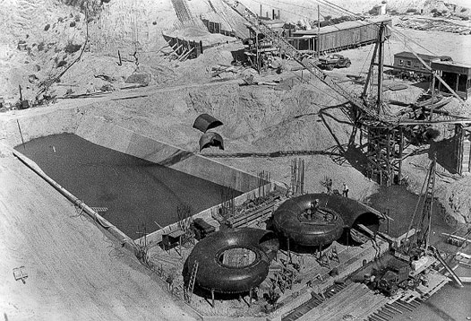 Central's JeffreHydroplant during early stages of construction. The spiral cases that carry water fromthe penstocks to the turbines are displayed prominently. Source — Central Nebraska Public Power and Irrigation District.