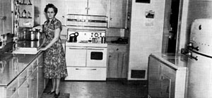 Electricity made life easier for everyone, including this woman and her family in a rural farmhouse in Phelps County. She stands in her kitchen with her new electric appliances. Source — Central Nebraska Public Power and Irrigation District.